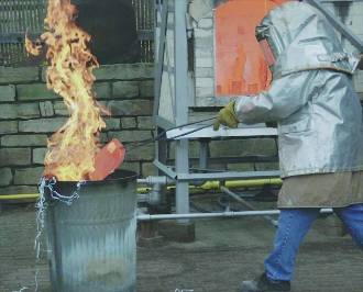 Professor demonstrating raku firing.