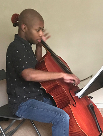 Laurence Bell practicing at home after UD moves to distance learning.