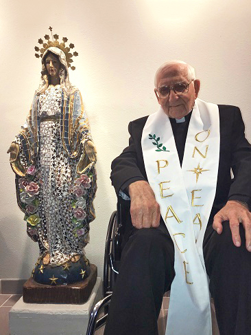 Monsignor Robert Rehkemper with Mary Statue