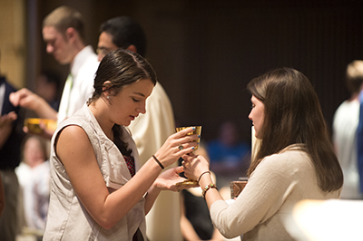students taking Communion